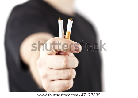 A hand crushing cigarettes - stock photo