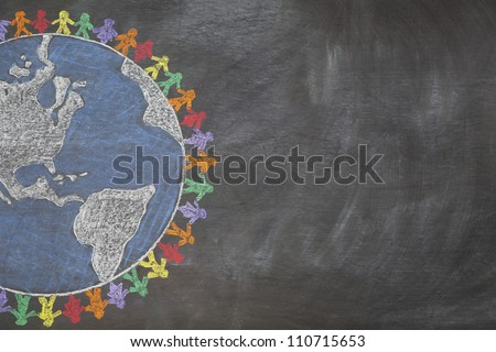 A hand drawn chalkboard shows multi-ratial people holding hands around the world to show care for the earth, peace, and unity.  Shown off centered for copy-space. - stock photo