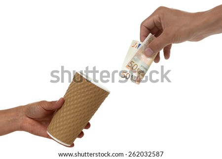 A hand giving a fifty euro bill to another hand that is holding a cup out begging or needing help and donations.  - stock photo