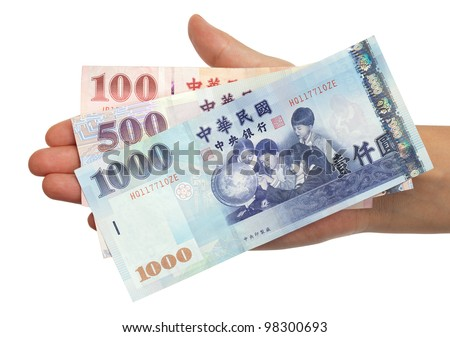 A hand holding a 100, 500 and 1000 New Taiwan Dollar bill. - stock photo