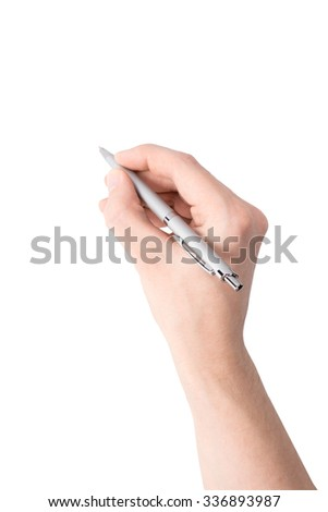 A hand holding a ballpoint pen on white background - stock photo