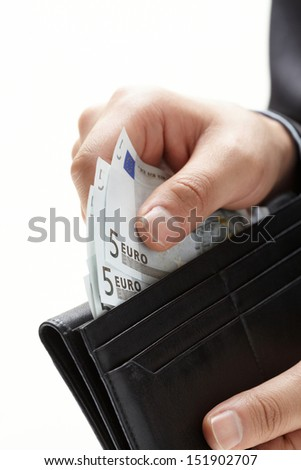 A hand holding an money with black wallet  - stock photo