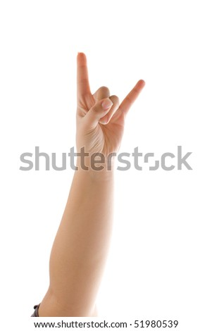 A hand holding up the devil horns sign isolated over white. - stock photo