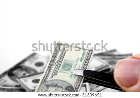 a hand holds miniature money representing the world financial crisis colorized for on black and white for impact isolated on white - stock photo