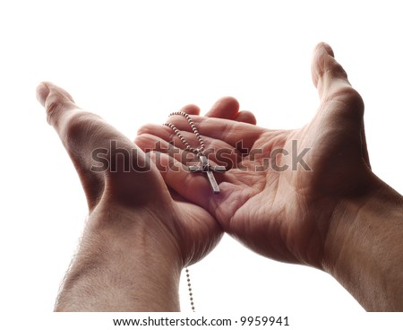 a hand is holding the cross in its palm - stock photo