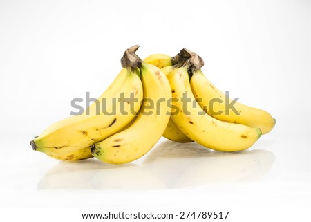 A hand of banana, separate into to and lean against each other in isolate white background - stock photo