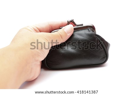 A hand on a closed purse  - stock photo