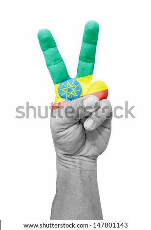 A hand painted with an Ethiopia flag making a V for victory symbol, isolated against white.  - stock photo