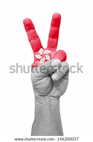 A hand painted with Hong Kong flag making a V for victory symbol, isolated against white.  - stock photo