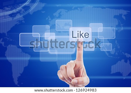 A hand pressing digital button of like in a futuristic touchscreen monitor over worldwide map - stock photo