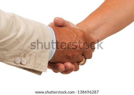 A hand shake between a man and woman. Isolated on white. - stock photo