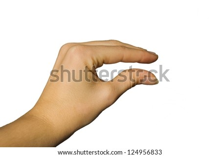 a hand showing something little or big between its fingers - stock photo