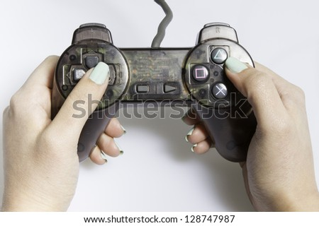 a hand with a game - stock photo