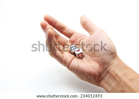 A hand with a pair of dice - stock photo