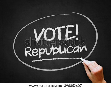 A hand writing 'Vote Republican' on chalkboard. - stock photo