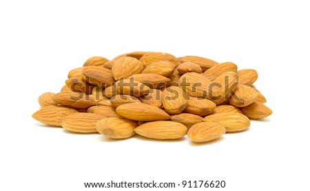 a handful of almonds on a white background closeup - stock photo