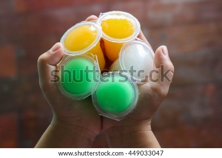A handful of colorful frozen jelly cones. - stock photo