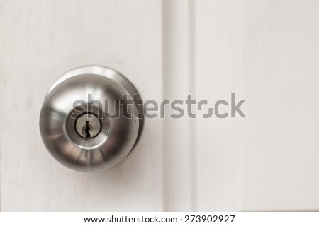 a handle on a door that is turned to release the latch - stock photo