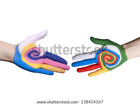 a handshake between two colorful painted hands, isolated - stock photo