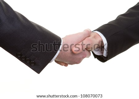 A handshake viewed from above - stock photo