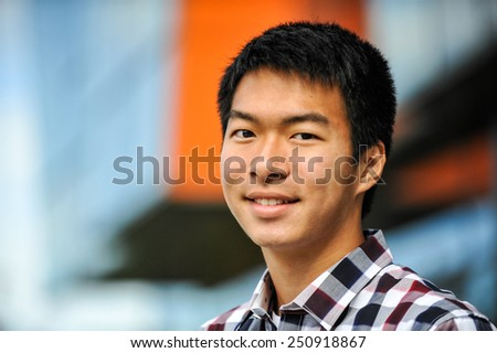 A handsome Asian young man - stock photo