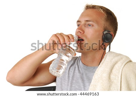 A handsome athletic man drinking water - stock photo