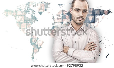 A handsome business man against world map on background with many different people's faces. Can represent a technology social network of friends and communication. - stock photo