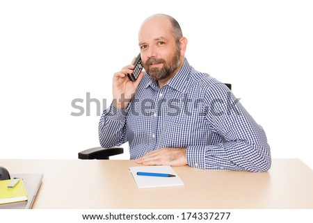 A handsome business man at the phone isolated on white background - stock photo