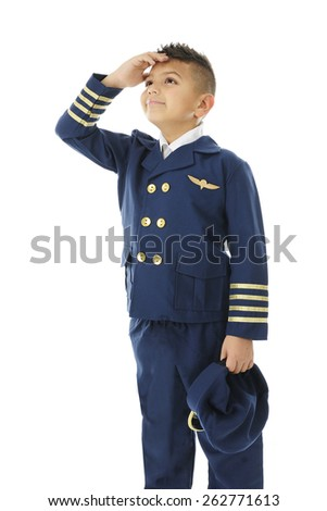 """A handsome elementary """"airline pilot"""" watching the sky with he hand shielding his eyes from the light.  On a white background - stock photo"""