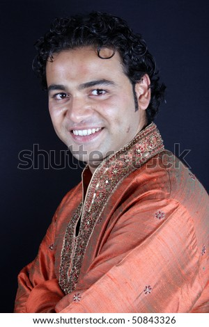 A handsome Indian groom in a traditional attire, at wedding. - stock photo