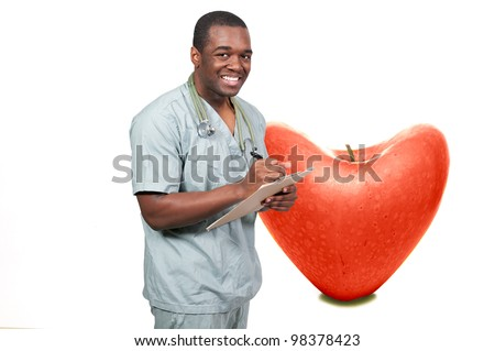 A handsome male doctor in a lab coat - stock photo