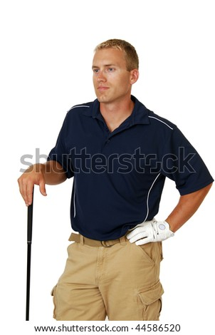 A handsome male golfer resting his hand on his club - stock photo