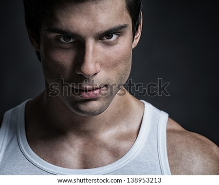A handsome male model posing at a studio. - stock photo