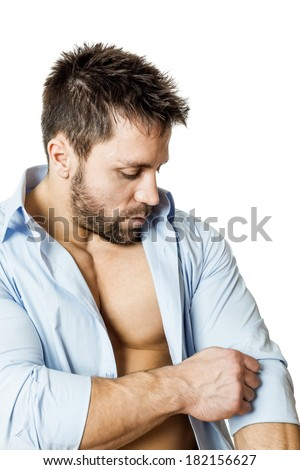 A handsome man with a beard roll up sleeve - stock photo