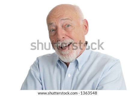 A handsome senior man looking very surprised. - stock photo