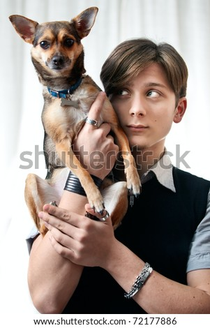 A handsome teenager posing on a white background in studio. Focus on model's face. - stock photo