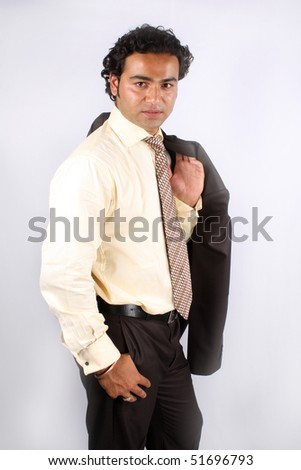 A handsome young Indian businessman, isolated on white studio background. - stock photo