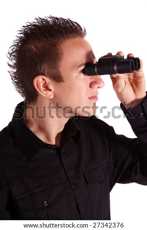 A handsome young man using a  spyglass. All on white background. - stock photo