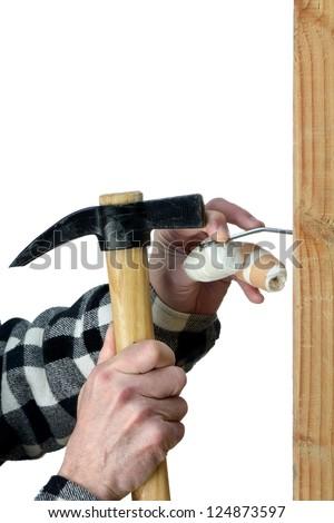 a handyman awkward trying to hammer a nail - stock photo