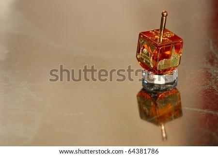 A Hanukkah spinning top-Dreidel - stock photo