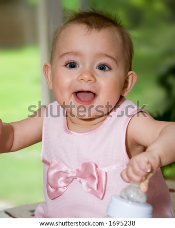 A happy baby girl just after feeding! - stock photo