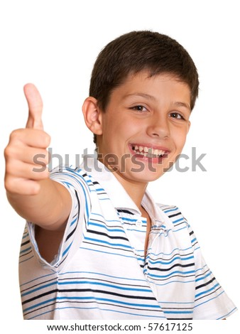 A happy boy is showing his right thumb; isolated on the white background - stock photo