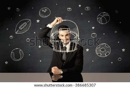 A happy college graduate dreaming about becoming a successful sports person while drawing helmet and ball in space concept - stock photo