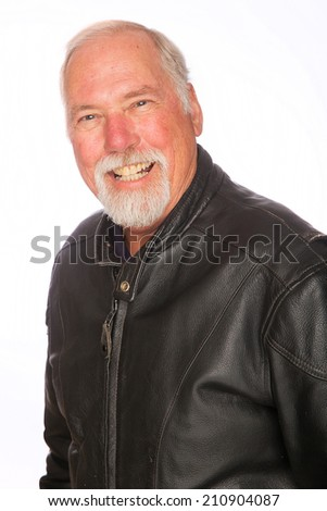 A happy, confident mature man wearing a black motorcycle jacket - stock photo