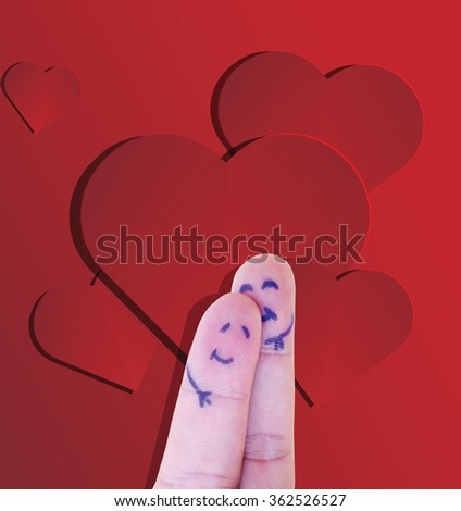 A happy couple in love with painted smiley and hugging with cut paper heart  background - stock photo