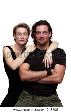 A happy couple isolated on white facing the camera - stock photo