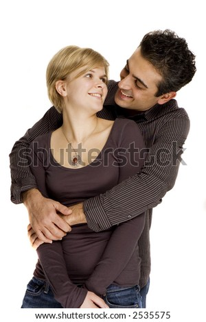 a happy couple posing and smiling for the camera - stock photo