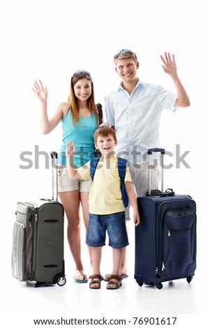 A happy family with their suitcases on a white background - stock photo