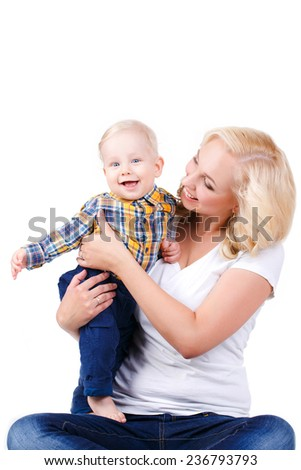 A happy family. young mother with baby. happy mother with baby isolated on white background. studio portrait.  picture of happy mother with baby over white. Mother holding sweet baby boy. - stock photo
