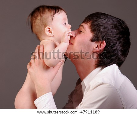 A happy father with his baby boy - stock photo